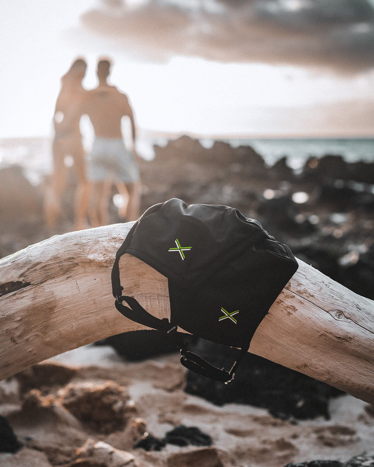 GuardeX masks and couple on the beach