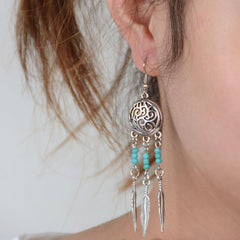 Hollow Out Totem Metal Feathers Tassel Earrings - Oh Yours Fashion - 1