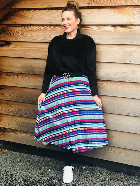 Put those jeans away, the pleated skirt has arrived!