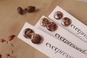 Real Red Rose flowers, real cocoa bean shells & faux gold foil set in crystal clear resin stud earrings with hypoallergenic posts.