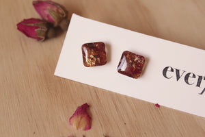 Real Red Rose flowers, cocoa bean shells & faux gold foil set in crystal clear resin stud earrings with hypoallergenic posts.