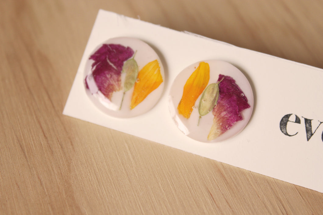 Hypoallergenic studs made with real rose petals, calendula petals and hoary alyssum set in crystal clear resin.