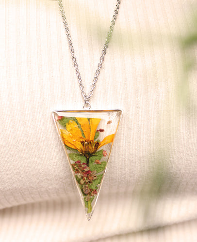Real Biden flower, Sorrel Flower buds and Fern Leaves set in crystal clear resin in a .925 sterling silver bezel.   The resin work is done completely by hand.