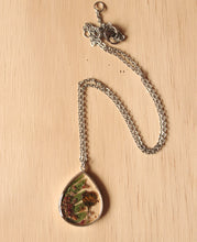 Load image into Gallery viewer, Real Fern leaves, Sorrel Flower Buds and Biden Flower Petals set in crystal clear resin in a .925 sterling silver bezel.   The resin work is done completely by hand.
