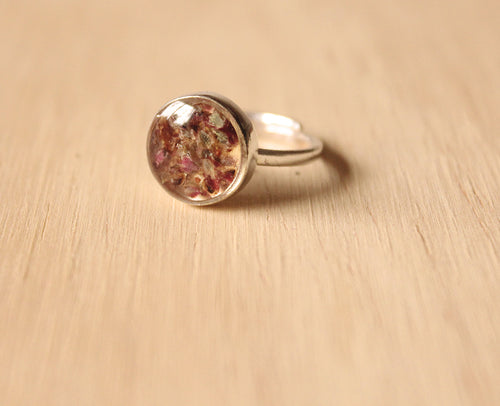 Real Sorrel flower buds set in crystal clear resin, encased in a 10mm sterling silver adjustable ring.
