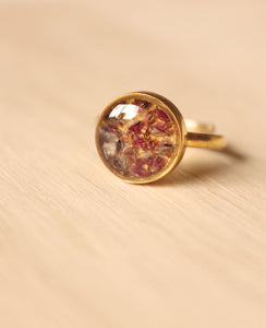 Real Sorrel flower buds set in crystal clear resin, encased in a 10mm gold plated sterling silver adjustable ring.