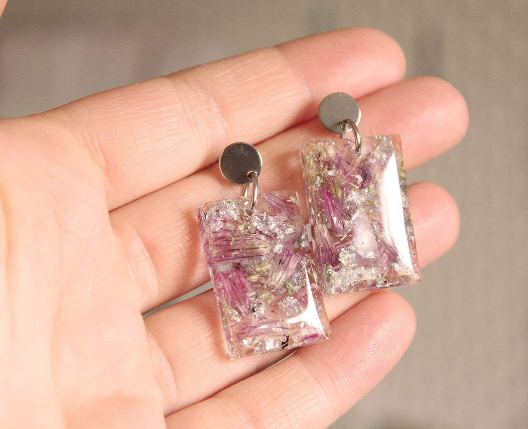 Real Chive Flowers, Baby's Breath & faux silver foil set in crystal clear resin. The texture in these earrings are stunning.  The resin work is done completely by hand.