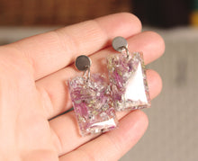 Load image into Gallery viewer, Real Chive Flowers, Baby's Breath & faux silver foil set in crystal clear resin. The texture in these earrings are stunning.  The resin work is done completely by hand.