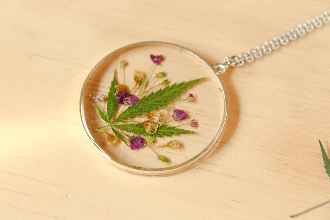 Real Bud Leaf, Alyssum Flowers and Goldenrod Flowers set in crystal clear resin in a .925 sterling silver bezel.