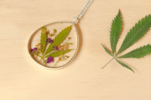 Leaf, Alyssum Flowers and Goldenrod Flowers set in crystal clear resin in a .925 sterling silver bezel.
