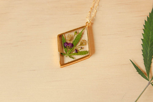 Real Leaf, Alyssum flowers and Goldenrod Flowers set in crystal clear resin in a .925 sterling silver gold plated bezel.
