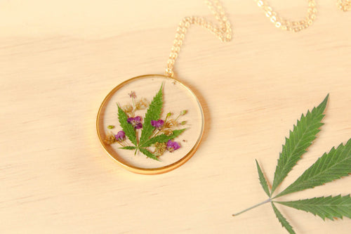 Leaf, Alyssum Flowers and Goldenrod Flowers set in crystal clear resin in a .925 sterling silver gold plated bezel.