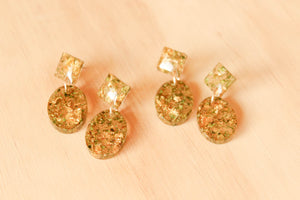 Real Cannabis and gold foil set in crystal clear resin. The texture in these earrings are stunning.