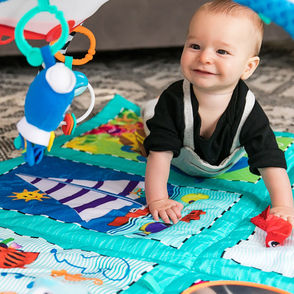 baby playing on a mat baby einstein