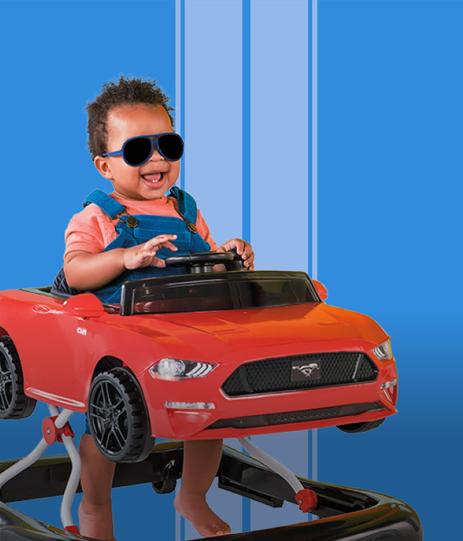 baby in john ford mustang rocker