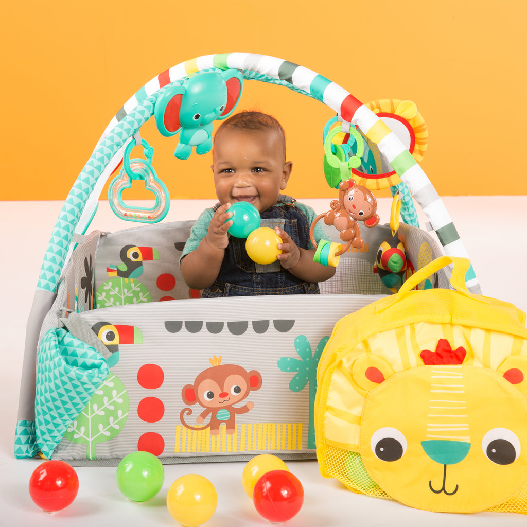 baby boy in a play gym