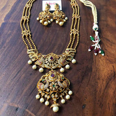 Matte Peacock AD Long Necklace Set (Ruby-Green)