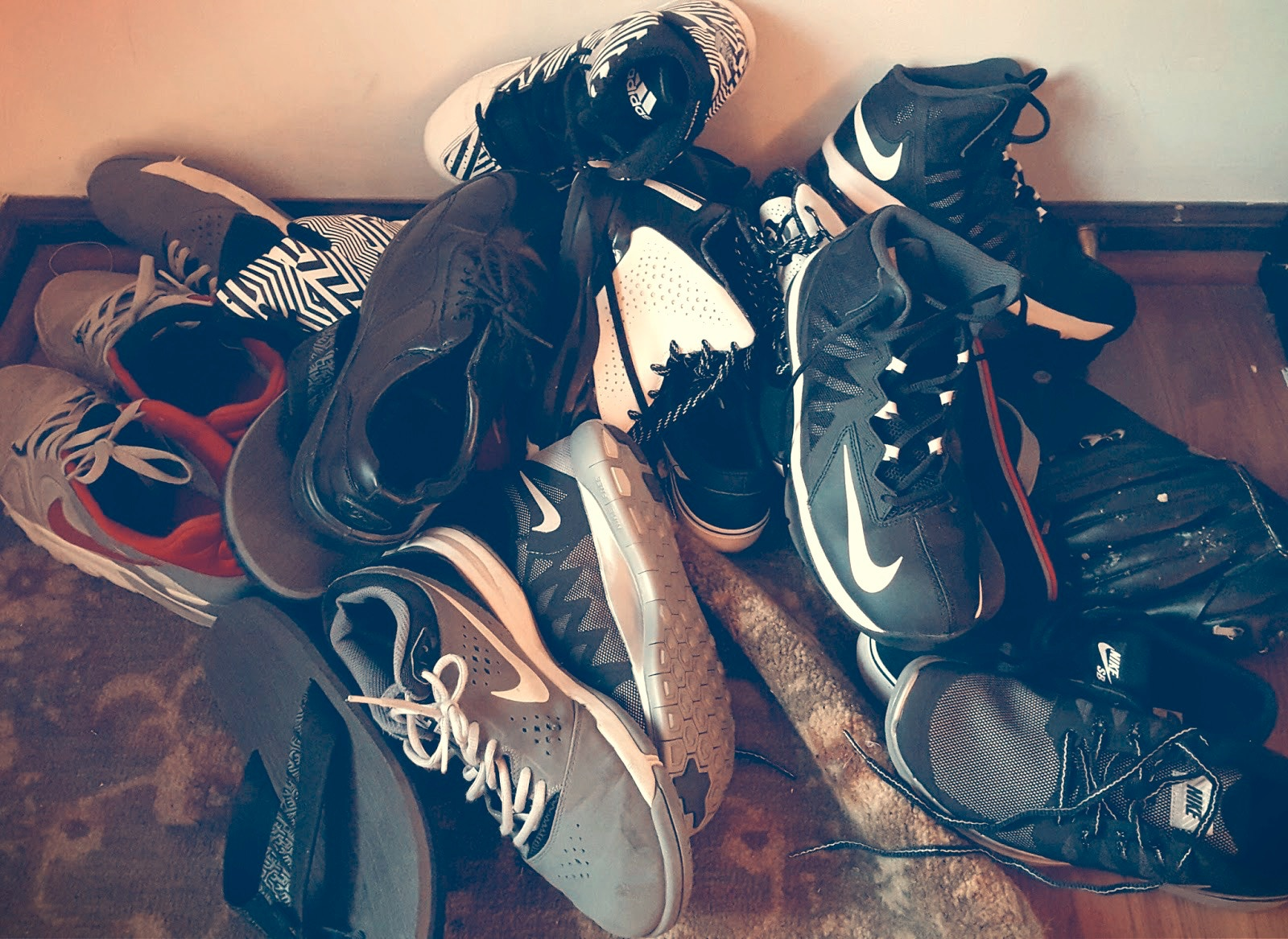 untidy stack of shoes thrown