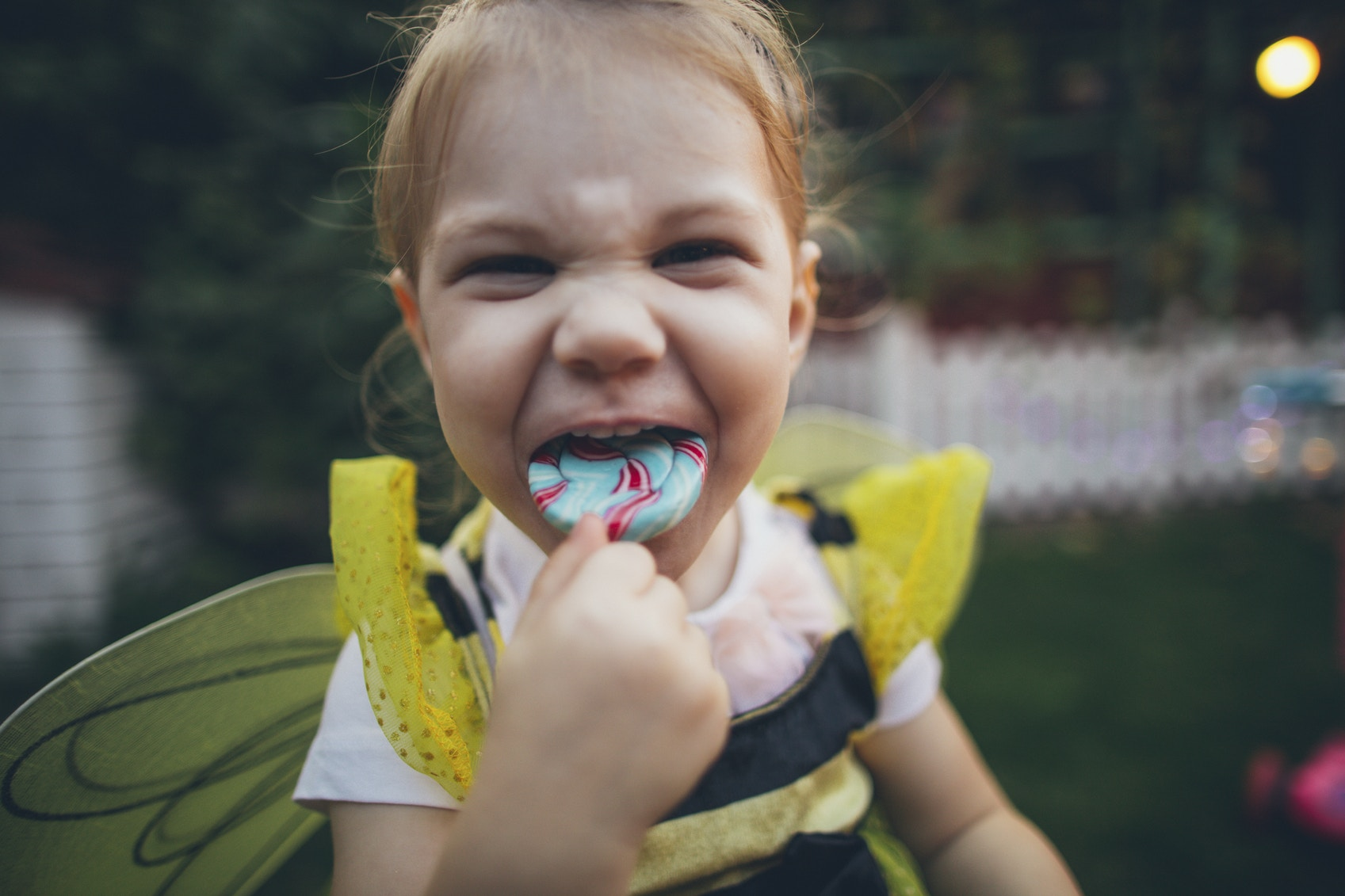 girl child eating lollipop