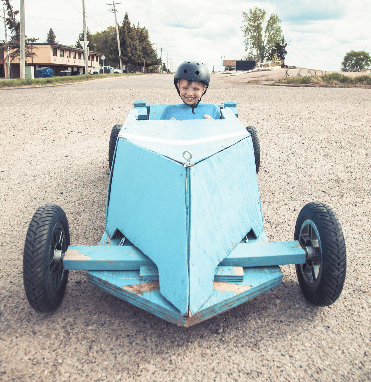 little boy in soapbox car