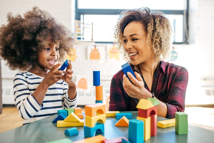 Teacher Playing Blocks With Her Son