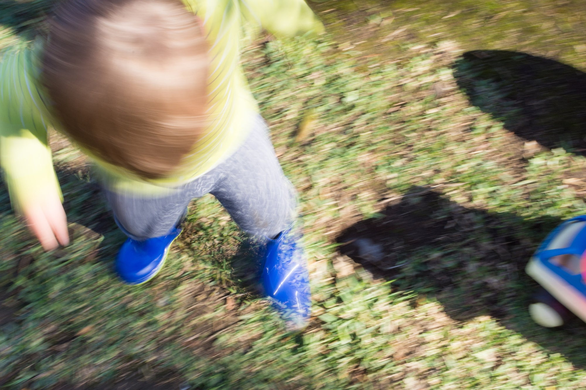 blur image of a kid playing in the garden