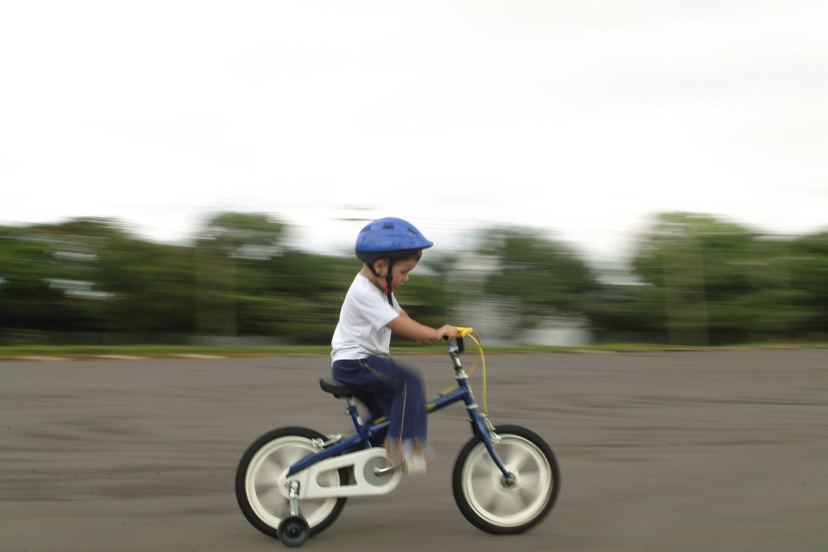 young boy riding biycle