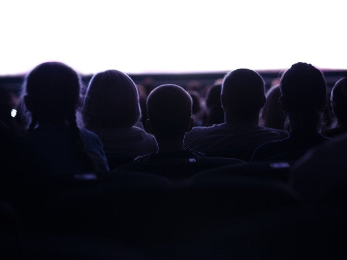audience watching a movie in theatre