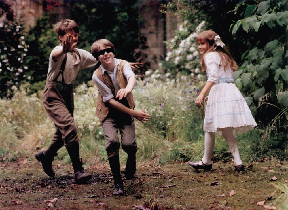 Three children playing blind fold