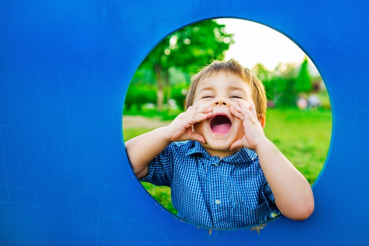 A child screaming from a circular window