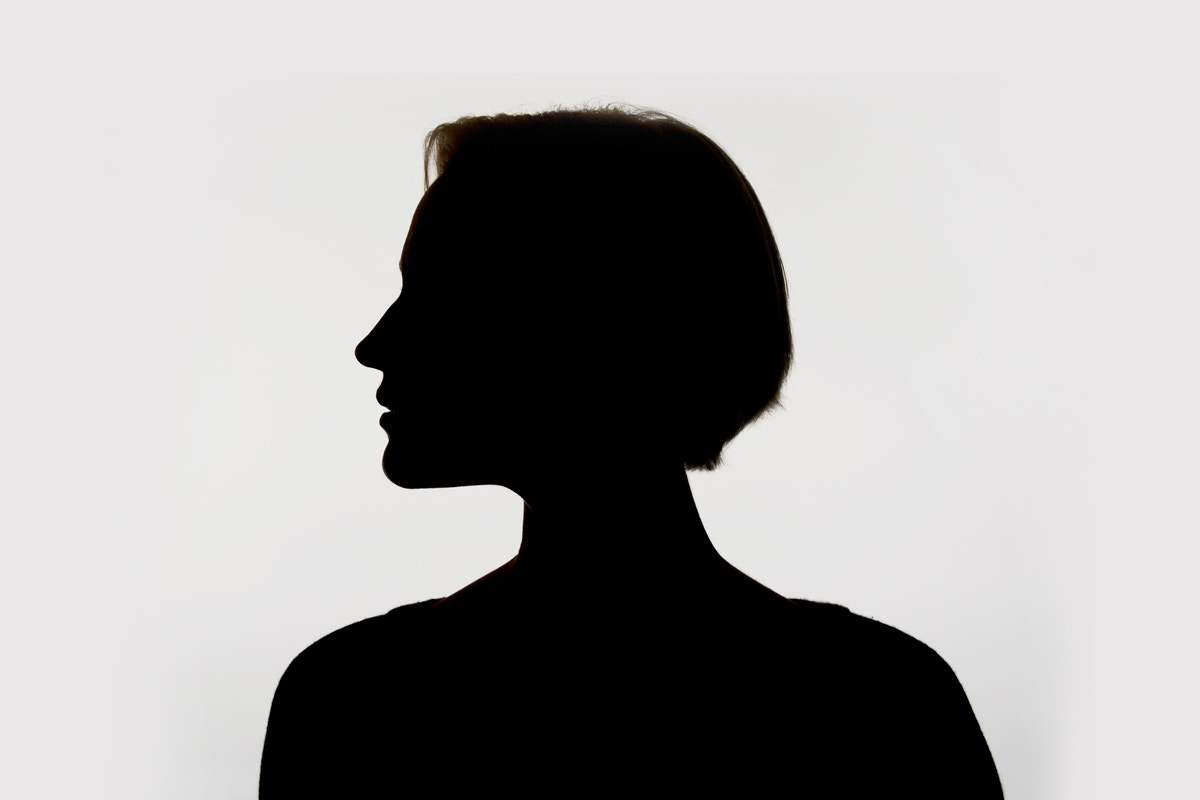 Silhouette of woman with short hair