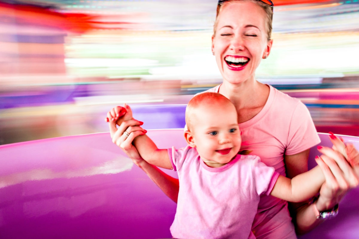 women laughing with her baby