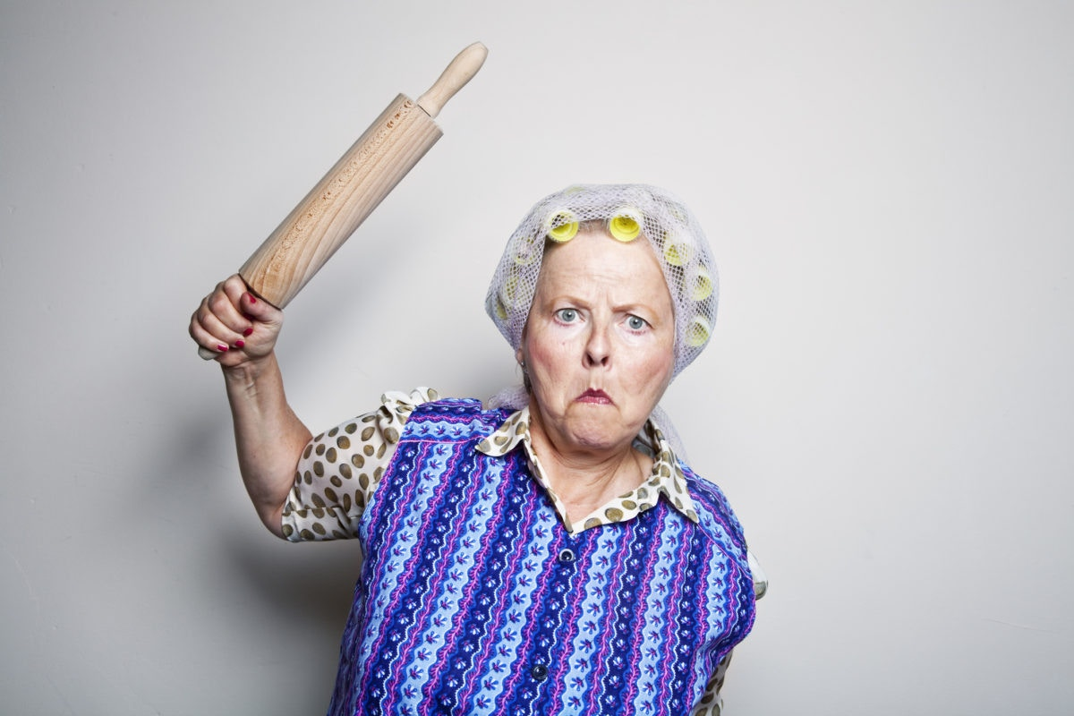 angry grand mother with rolling pin