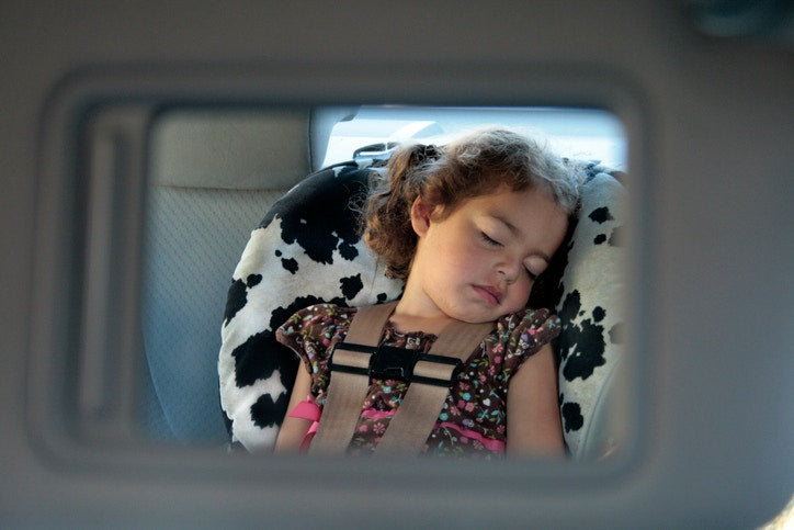 Baby Girl Sleeping In A Car Seat.