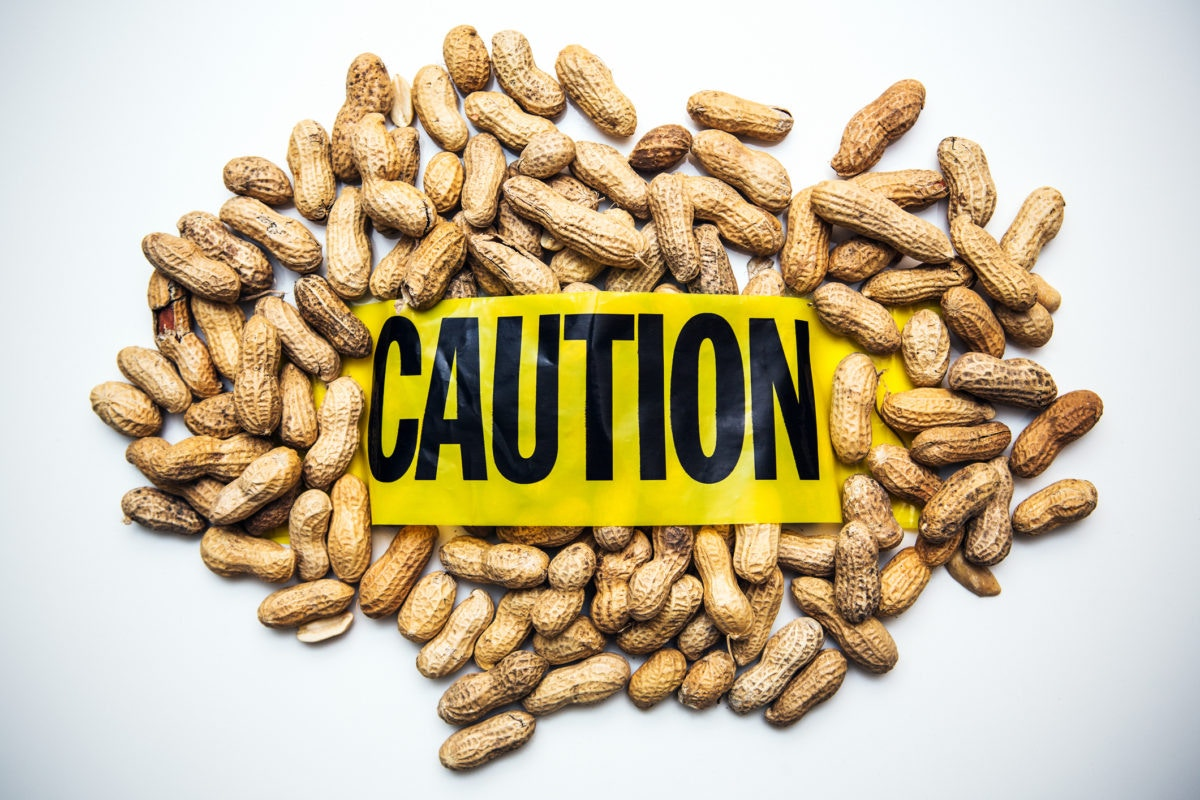 groundnuts with caution poster