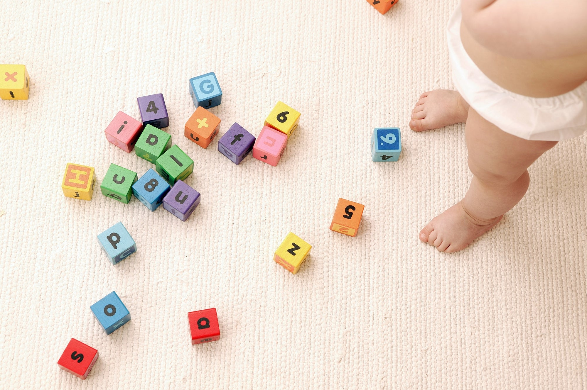 toy cubes with numbers and alphabets