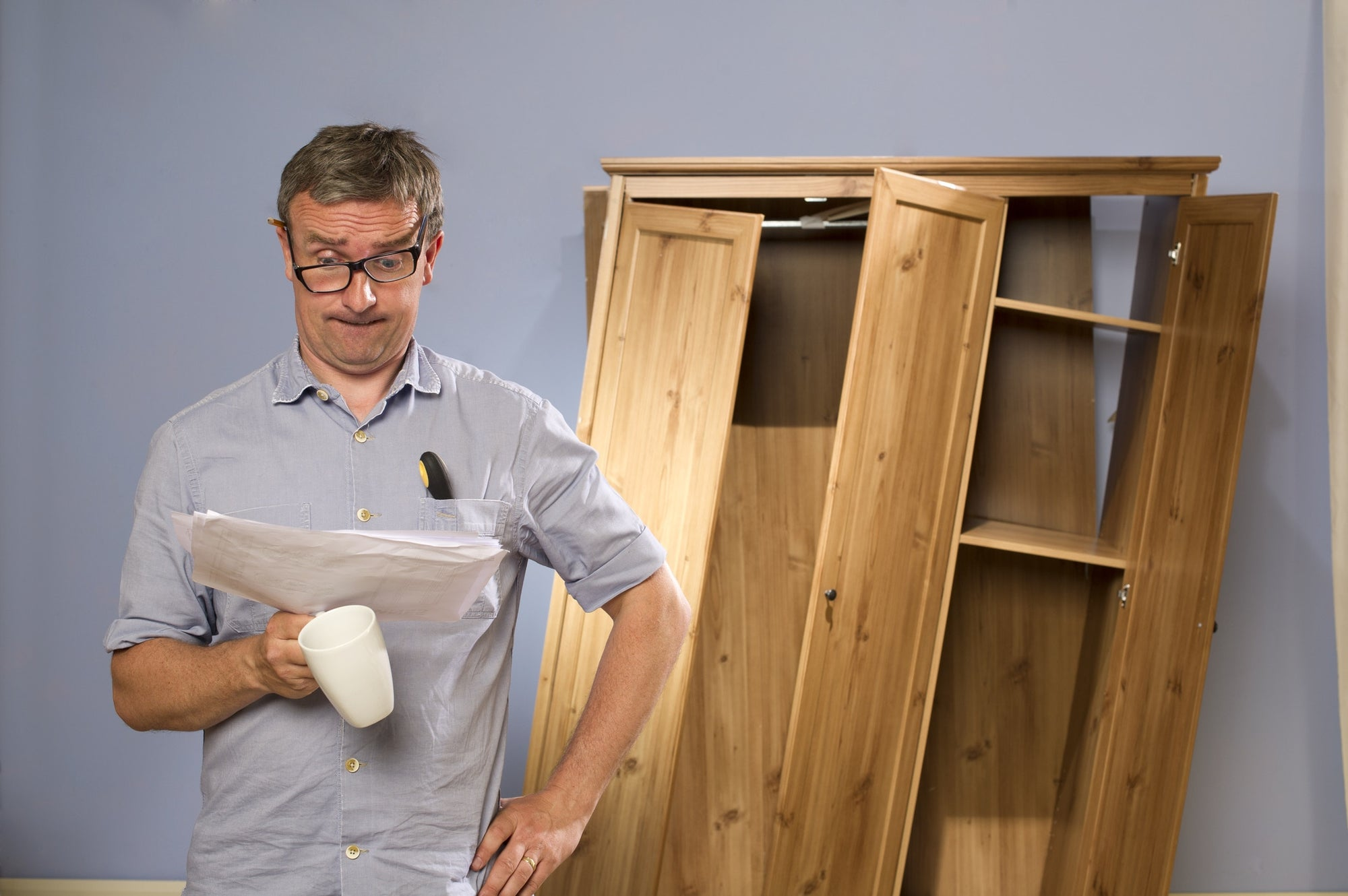 Man Confused Of Assembling Furniture Reading Manual