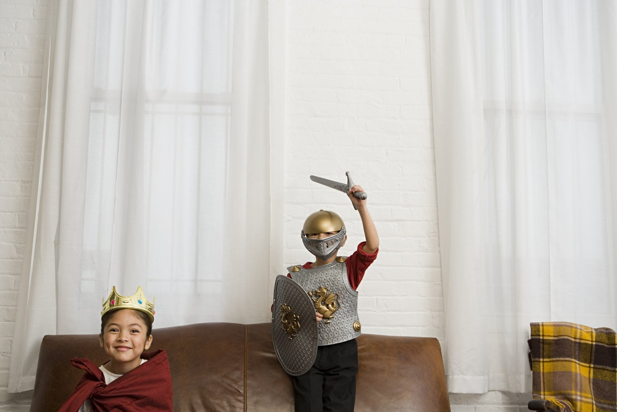 Boys in knight costume in living room