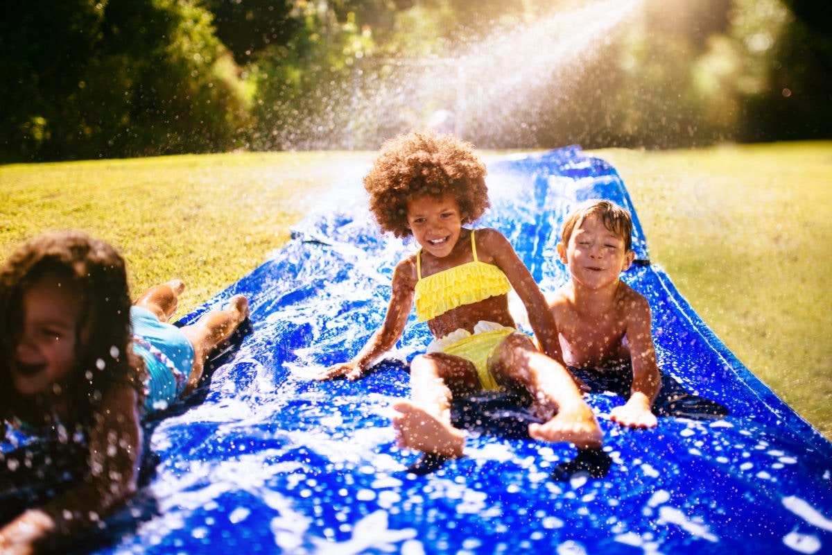 kids pplaying in Homemade Water Slide