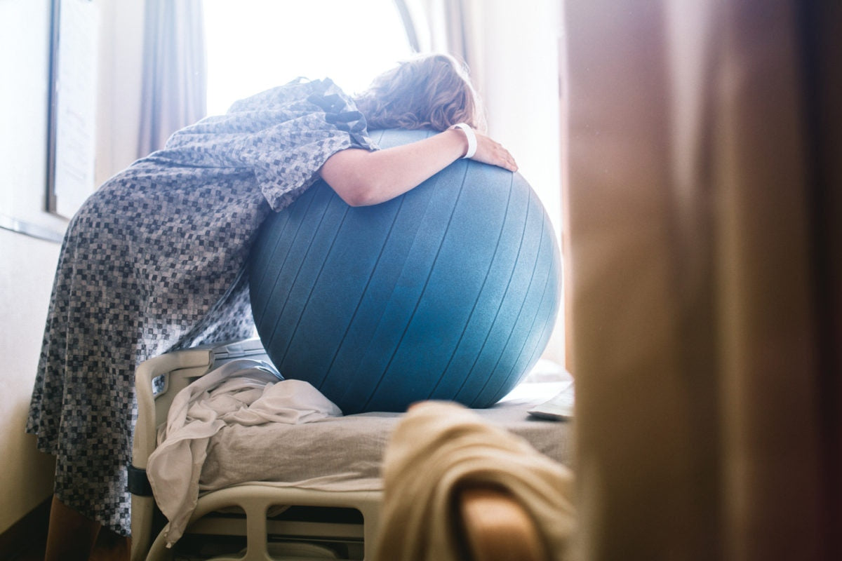 woman using a birthing ball in hospital