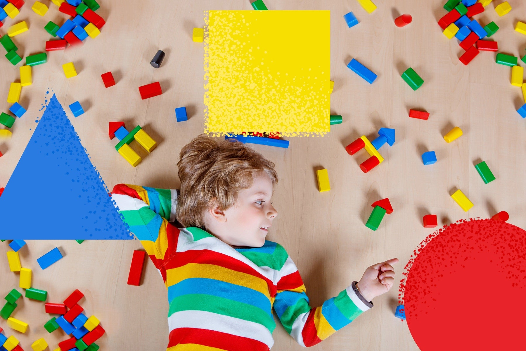child lying in middle of lego blocks