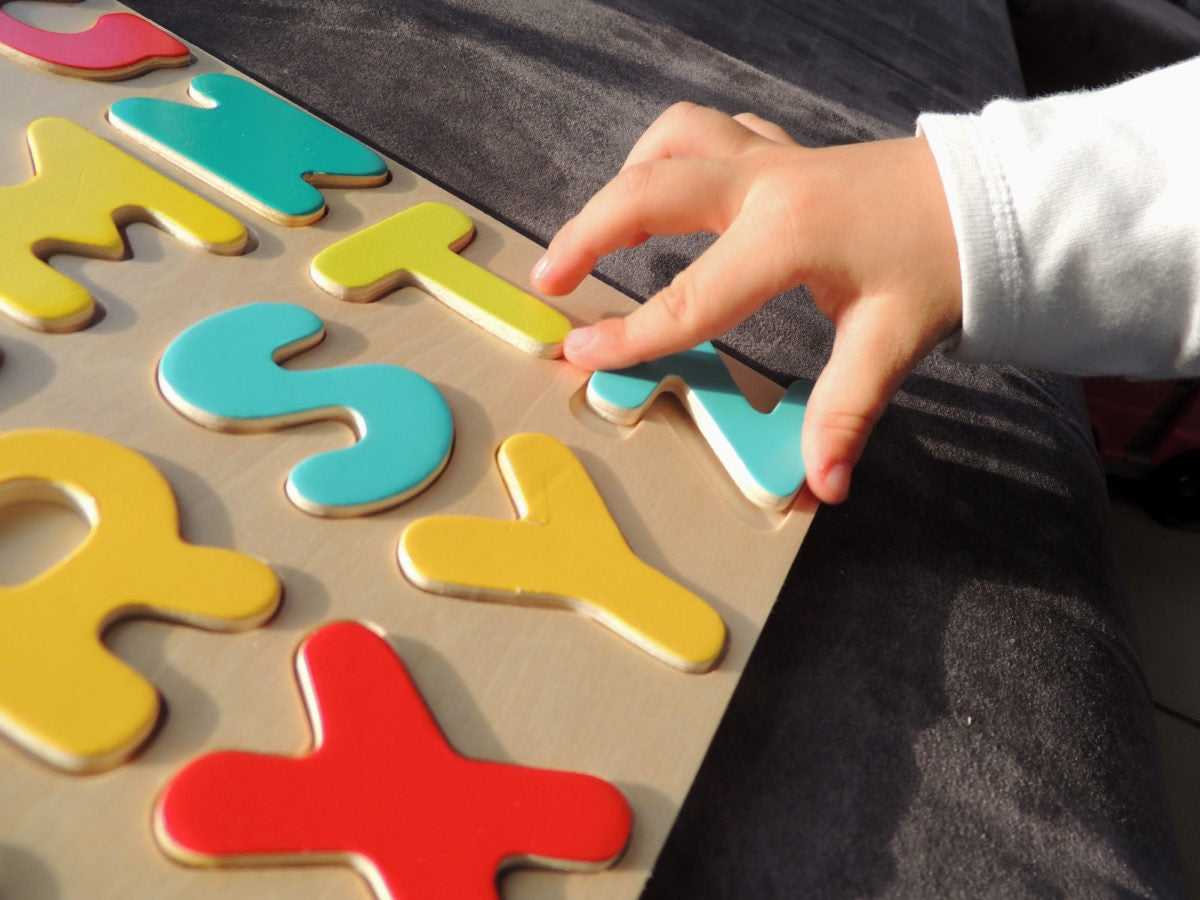 Child is rearranging alphabet letters