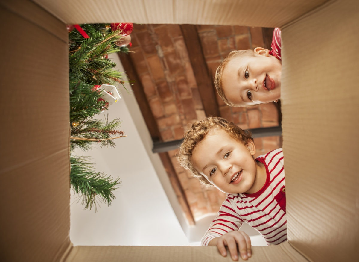 Two kid watching through an opened box