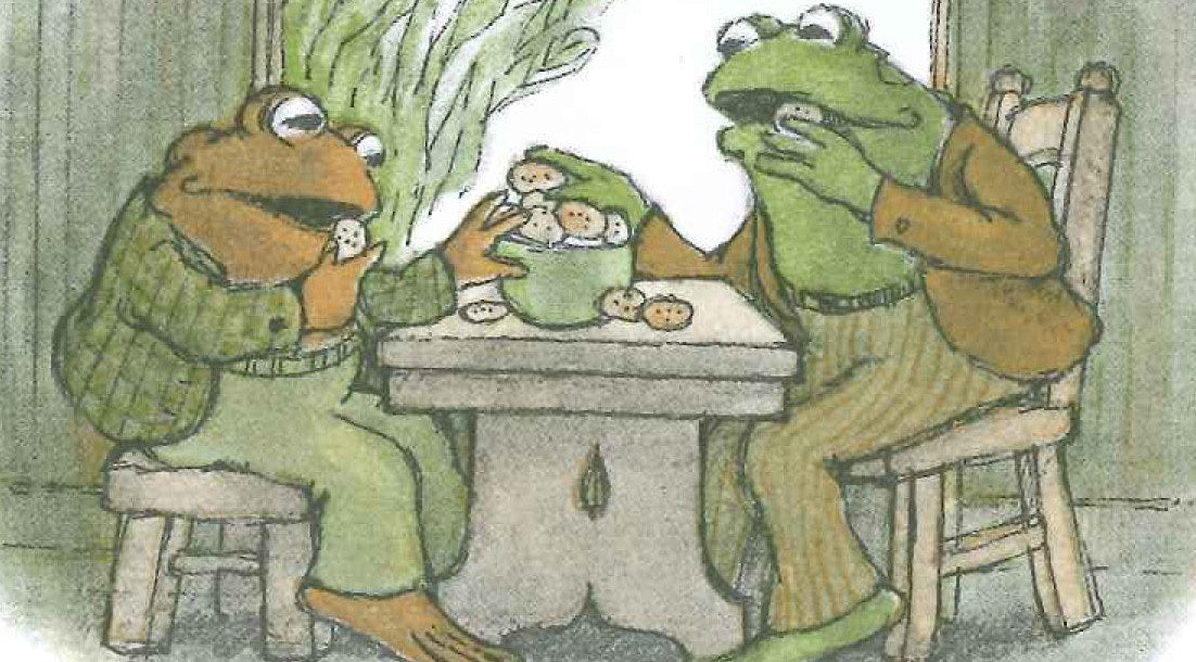 Two funny frog eating with well dressed