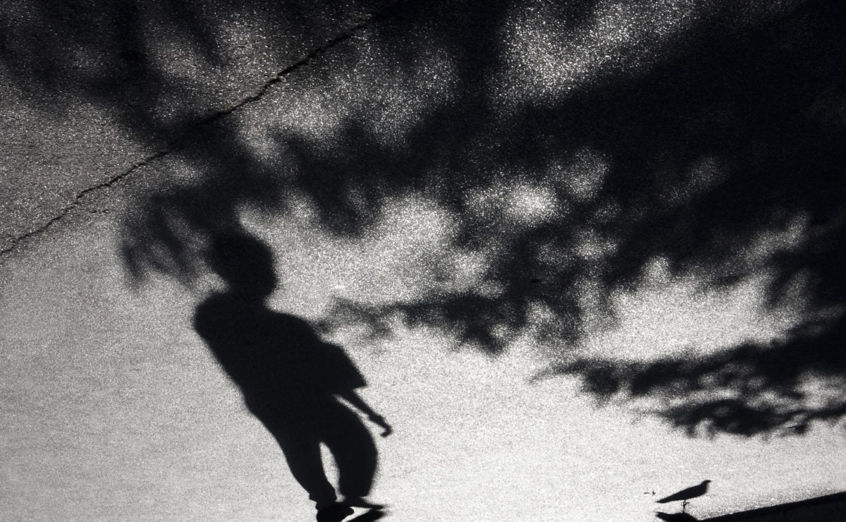 Boy standing in shadow