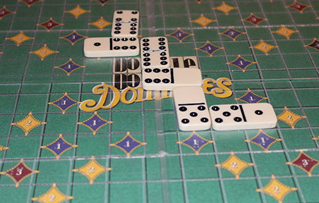 shot of the dominoes fitting on the board.