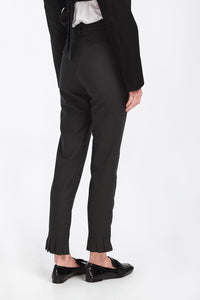 Trousers grey, with asymmetric pleated details at the end
