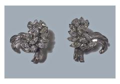 Pair of Platinum and Diamond spray Earrings with clips, C.1960
