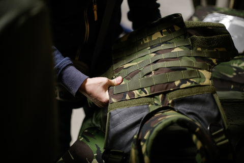 Military green and camo body armour vest
