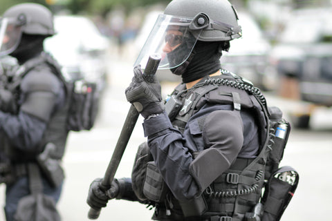 Special police ops dressed in full tactical gear including body armour
